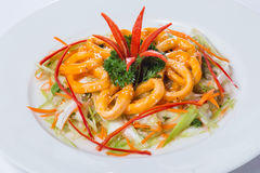 Vietnamese ring squid salad on white plate in restaurant Royalty Free Stock Photography