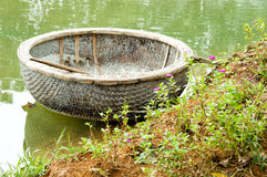 Vietnamese round boat in green water.  Royalty Free Stock Photos