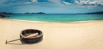 Vietnamese round boat. White sand beach. Vietnam. Panorama. Beautiful white sand beach. Vietnamese round boat on a foreground. Beautiful landscape of Vietnam stock image