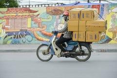 Vietnamese sales man on his motorbike Royalty Free Stock Image
