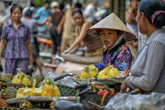 Vietnamese sales woman in Hanoi. A street vendor with her goods on the market in the streets of the old quarter in Hanoi, Vietnam Stock Images