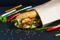 Vietnamese sandwich on the background. Vietnamese sandwich on the dark background Stock Image