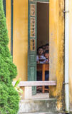Vietnamese School Children Peeking from Classroom Royalty Free Stock Photo