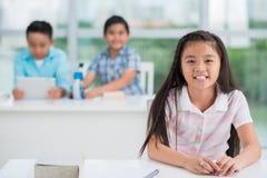 Vietnamese schoolgirl at her desk Stock Photos