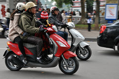 Vietnamese Scooter Riders Stock Images