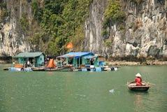 Vietnamese sea gypsy village in halong bay Stock Photos