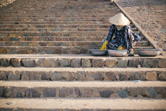 Vietnamese seller. Vietnamese selling her fish which just capture it from the sea on the stair of the street Royalty Free Stock Photos