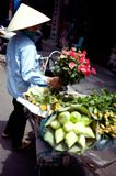 Vietnamese selling flowers. Hoi An in Vietnam boatman to do the tourist trade royalty free stock photos