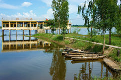 Vietnamese shool in flooded season. DONG THAP, VIET NAM- SEPT 19: Landscape of Vietnamese shool in flooded season, shool reflect on water, group of row boat Stock Photos