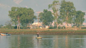 Vietnamese small round basket boat floats on the river. two boats.White stork. stock video footage