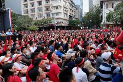 Vietnamese soccer supporters watch AFC U23 final match. HO CHI MINH CITY, VIET NAM- JAN 27, 2018:  Amazing with large crowd of Vietnamese soccer supporters Royalty Free Stock Images