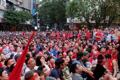 Vietnamese soccer supporters watch AFC U23 final match. HO CHI MINH CITY, VIET NAM- JAN 27, 2018:  Amazing with large crowd of Vietnamese soccer supporters Royalty Free Stock Image