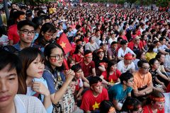 Vietnamese soccer supporters watch AFC U23 final match Stock Photo