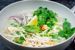 Vietnamese soup Pho GA. On bowl stock photos