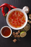 Vietnamese spicy sauce Nuoc Cham with the ingredients closeup. v Royalty Free Stock Images