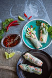 Vietnamese spring rolls with prawns and dipping sauce. Vietnamese spring rolls with prawns, vermicelli, cucumber and dipping sauce on metal background royalty free stock images