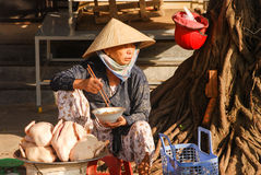 Vietnamese steet vendor have lunch Stock Photography