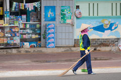 Vietnamese street cleaner works Royalty Free Stock Images