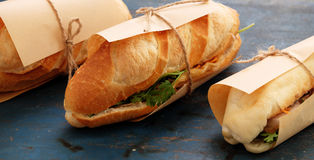 Vietnamese street food, banh mi thit. Famous Vietnamese food is banh mi thit, popular street food from bread stuffed with raw material: pork, ham, pate, egg and Royalty Free Stock Photography
