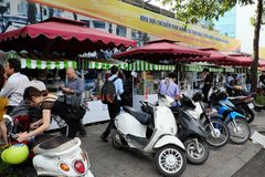 Vietnamese street food on food cart. HO CHI MINH CITY, VIET NAM- DEC 1, 2017: Group of food cart on pavement  that sell Vietnamese street food at morning in Royalty Free Stock Image