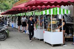 Vietnamese street food on food cart. HO CHI MINH CITY, VIET NAM- DEC 1, 2017: Group of food cart on pavement  that sell Vietnamese street food at morning in Royalty Free Stock Images
