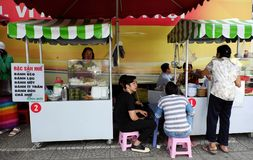 Vietnamese street food on food cart. HO CHI MINH CITY, VIET NAM- DEC 1, 2017: Group of food cart on pavement  that sell Vietnamese street food at morning in Stock Images