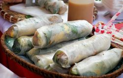 Vietnamese street food, rice paper rolls. Famous snack of Binh Dinh at cuisine fair, Ho Chi Minh city, Vietnam, roll make with ingredient  as meat, egg Royalty Free Stock Image