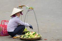 Vietnamese street fruit seller Royalty Free Stock Photo