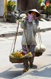 Vietnamese street seller. Vietnamese woman street seller in Hoi An, Vietnam stock image