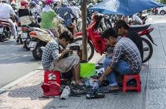 Vietnamese street shoe makers Royalty Free Stock Image