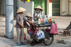 Vietnamese street vendor. Ho Chi Minch City, Vietnam December 10, 2013. Unidentified Vietnamese street vendor communicates with other woman on December 10, 2013 Stock Images