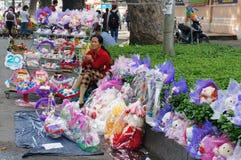 Vietnamese street vendor, flower outdoor market Royalty Free Stock Images