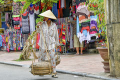 Vietnamese street vendor in Hoi An Royalty Free Stock Image