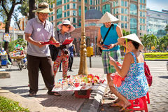 A Vietnamese street vendors selling souvenirs to tourists on No Stock Photo