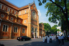 Vietnamese student, ao dai, Saigon Notre Dame Cathedral. HO CHI MINH CITY, VIET NAM- NOV 24: Crowd of Vietnamese student in traditional dress, ao dai, shooting Royalty Free Stock Photo