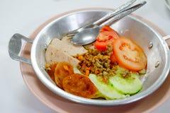 Vietnamese style breakfast, fried egg in pan Stock Photo
