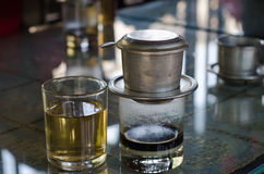 Vietnamese style coffee. Coffee dripping in vietnamese style on  table Stock Photo