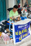 Vietnamese tailor at work Royalty Free Stock Photos