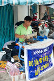 Vietnamese tailor works at sewing machine Royalty Free Stock Photos