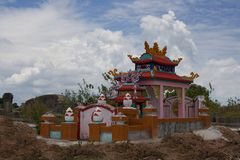 Vietnamese tomb in the cemetery surrounded by hill of clay. Hue, Central Vietnam, Asia Royalty Free Stock Photos