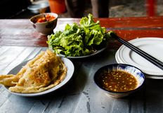 Banh Xeo Xeo cake - a Vietnamese savory fried pancake. Vietnamese traditional Food- a Vietnamese savory fried pancake royalty free stock photography