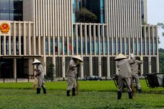 Vietnamese tuinarbeiders Stock Afbeelding