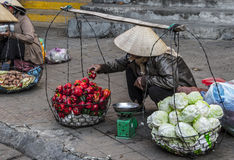 Vietnamese vendors selling fruit and vegetables. At Dalat city market, Vietnam Stock Image