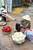 Vietnamese vendors selling fruit and vegetables Stock Photo