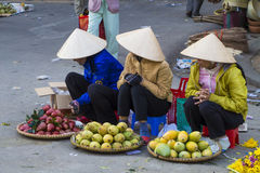 Vietnamese vendors selling fruit and vegetables at Dalat market Stock Photography