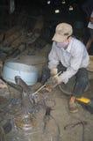 Vietnamese welder on the sidewalk royalty free stock photography