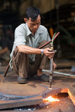 Vietnamese welders Stock Images