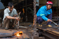 Vietnamese welders Royalty Free Stock Photos