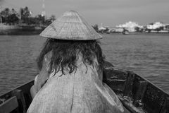 Vietnamese woman from the back on a rowing boat at Can Tho`s floating market stock photography