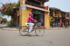 Vietnamese woman with bicycle Royalty Free Stock Photography